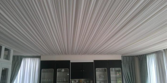 A tented ceiling in a house